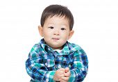 stock photo of snickers  - Asian baby boy isolated - JPG