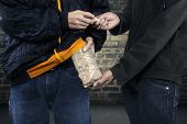 pic of crack addiction  - Two drug dealer taking money for heroine - JPG