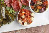 stock photo of antipasto  - Feta cheese and sundried tomato on an antipasto platter - JPG