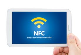pic of payment methods  - Hand holding tablet with NFC chip - JPG
