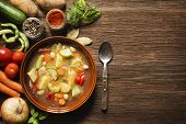 image of stew  - Fresh vegetable stew on wooden background overhead shoot - JPG