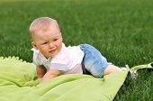 picture of creeping  - Little boy on green blanket creeping and looking somewhere