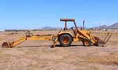 picture of dozer  - Yellow bull dozer on the construction site in an open field - JPG