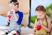 picture of cabana  - Kids at luxury resort relaxing at beach cabana and drinking tropical juices - JPG