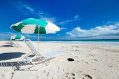 picture of caribbean  - Chairs and umbrellas on a beautiful Caribbean beach - JPG
