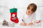 foto of letters to santa claus  - Boy writes a letter to Santa Claus - JPG