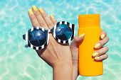picture of sun tan lotion  - Summer fashion and beauty hand care concept - JPG