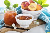 picture of vanilla  - Vanilla peach jam in a bowl with vanilla sticks and fresh peaches  - JPG