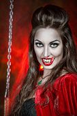 foto of long tongue  - Beautiful halloween vampire woman with long tongue - JPG