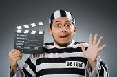 pic of inmate  - Inmate with movie clapper board - JPG