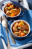 foto of stew pot  - beef stew with potato and carrot in blue pots  - JPG