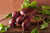 stock photo of beet  - fresh beet in wooden bowl - JPG