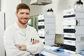 stock photo of chemistry technician  - researcher man at scientific analysing work in chemistry laboratory - JPG