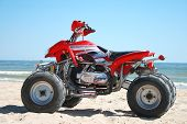 foto of four-wheel drive  - Four wheel drive red and black quad bike - JPG