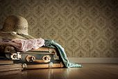 foto of packing  - Holiday packing with vintage suitcase and polka dot clothing on hardwood floor - JPG