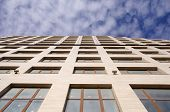 stock photo of premises  - Modern new office building in the sky in sunny day - JPG