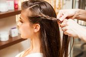 picture of braids  - young woman in hair salon making braid of hair - JPG
