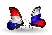 foto of holland flag  - Two butterflies with flags on wings as symbol of relations Holland and Russia - JPG