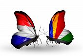 stock photo of holland flag  - Two butterflies with flags on wings as symbol of relations Holland and Seychelles - JPG