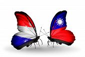 image of holland flag  - Two butterflies with flags on wings as symbol of relations Holland and Taiwan - JPG