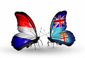 picture of holland flag  - Two butterflies with flags on wings as symbol of relations Holland and Fiji - JPG