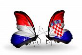 stock photo of holland flag  - Two butterflies with flags on wings as symbol of relations Holland and Croatia - JPG