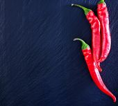 foto of red hot chilli peppers  - red hot chilli peppers on the black table - JPG