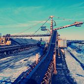 pic of iron ore  - conveyor transport for loading iron ore from the warehouse - JPG