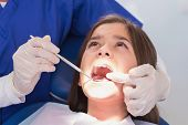 foto of pediatric  - Pediatric dentist examining her young patient in dental clinic - JPG