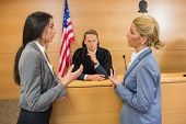 picture of court room  - Lawyers speaking with the judge in the court room - JPG