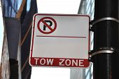 stock photo of towing  - A white and red blank space no parking tow zone street sign - JPG