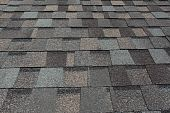 stock photo of shingles  - A newly installed composition asphalt shingle roof - JPG