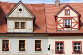 stock photo of red roof tile  - Traditional timbered house with red roof clay tiles - JPG