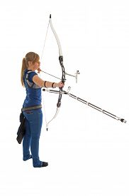 stock photo of longbow  - Young girl with blue shirt and jeans aiming with a longbow - JPG