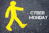 picture of monday  - Yellow pedestrian figure on the road walking towards CYBER MONDAY - JPG
