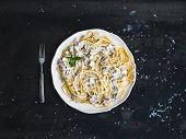 pic of mushroom  - Pasta spaghetti with creamy mushroom sauce and basil in white ceramic plate over old grunge dark table - JPG