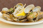 picture of clam  - Chinese baby clams sauteed in sweet and spicy black bean sauce with lemon wedge - JPG