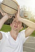 image of early 20s  - Young man shooting free throws from the foul line - JPG