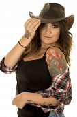 picture of cowgirl  - A cowgirl in her plaid shirt and western hat with her tattoo off of her shoulder - JPG