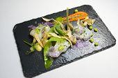 stock photo of scallops  - Marinated scallops served on a black slate - JPG