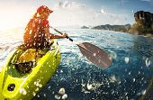 pic of paddling  - Young lady paddling the kayak in the sea with lots of splashes - JPG