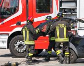 Постер, плакат: Firefighters Take Off The Hood Of The Car After A Serious Car Accident