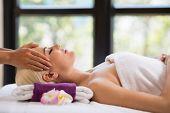 foto of scalping  - Woman getting professional head massage at spa resort - JPG