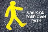 foto of pedestrians  - Yellow pedestrian figure on the road walking towards Walk On Your Own Path - JPG