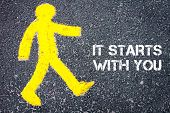 picture of start over  - Yellow pedestrian figure on the road walking towards IT STARTS WITH YOU - JPG