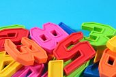 foto of blue things  - Colorful plastic numbers close up on a blue background - JPG