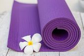 pic of yoga mat  - purple yoga mat on the white and vintage table - JPG