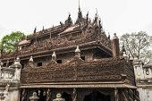 stock photo of significant  - Shwenandaw Kyaung temple or Golden Palace Monastery is one of the most significant historic buildings in Mandalay - JPG