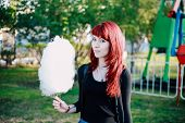 picture of candy cotton  - cotton candy girl park walk sun happy - JPG