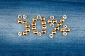stock photo of fifties  - Fifty percent made from crystals on jeans fabric as background - JPG